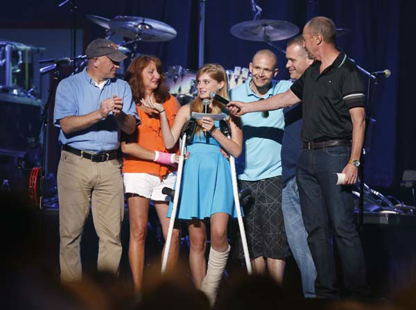 Boston Marathon bombing victim Victoria McGrath, 20, center, thanks people who help her when she was injured and help her recovery during the Boston Strong Concert: An Evening of Support and Celebration at the TD Garden on Thursday, May 30, 2013 in Boston. &#40;Photo by Bizuayehu Tesfaye&#47;Invision&#47;AP&#41; <span class=meta>(AP Photo&#47; Bizuayehu Tesfaye)</span>