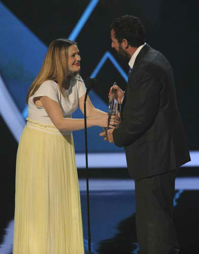 Drew Barrymore, left, presents the award for favorite comedic movie actor to Adam Sandler, right,  at the 40th annual People&#39;s Choice Awards at the Nokia Theatre L.A. Live on Wednesday, Jan. 8, 2014, in Los Angeles. &#40;Photo by Chris Pizzello&#47;Invision&#47;AP&#41; <span class=meta>(Photo&#47;Chris Pizzello)</span>