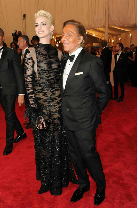 Actress Anne Hathaway and designer Valentino Garavani attend The Metropolitan Museum of Art&#39;s Costume Institute benefit celebrating &#34;PUNK: Chaos to Couture&#34; on Monday, May 6, 2013 in New York. &#40;Photo by Evan Agostini&#47;Invision&#47;AP&#41; <span class=meta>(AP Photo&#47; Evan Agostini)</span>