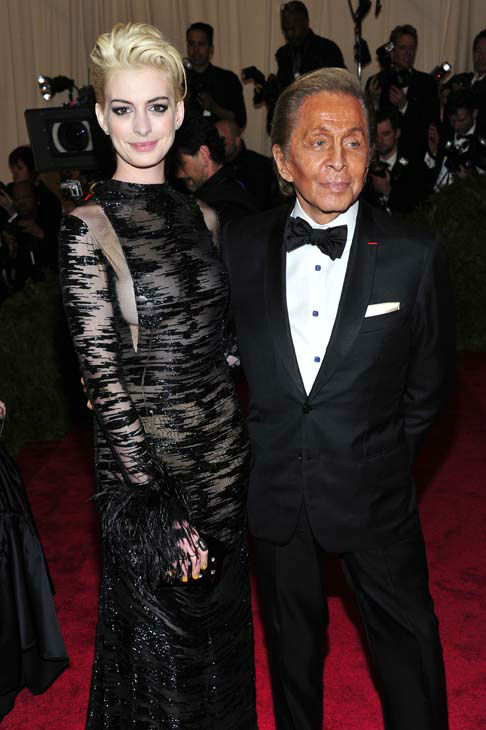 Anne Hathaway, left, and Valentino Garavani attends The Metropolitan Museum of Art&#39;s Costume Institute benefit celebrating &#34;PUNK: Chaos to Couture&#34; on Monday May 6, 2013 in New York. &#40;Photo by Charles Sykes&#47;Invision&#47;AP&#41; <span class=meta>(AP Photo&#47; Charles Sykes)</span>