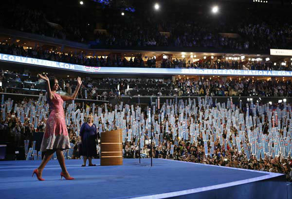 "<div class=""meta ""><span class=""caption-text "">First Lady Michelle Obama waves to delegates at the Democratic National Convention in Charlotte, N.C., on Tuesday, Sept. 4, 2012. (AP Photo/Jae C. Hong) (AP Photo/ Jae C. Hong)</span></div>"