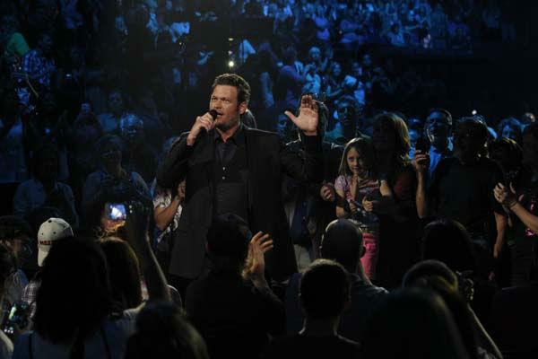 This image released by NBC Universal shows country singer Blake Shelton during the Healing in the Heartland: Relief Benefit Concert at the Chesapeake Energy Arena in Oklahoma City, Okla., Wednesday, May 29,2013. Funds raised by the benefit will go to the United Way of Central Oklahoma, for recovery efforts for those affected by the May 20 tornado. &#40;AP Photo&#47;NBC, Brett Deering&#41; <span class=meta>(AP Photo&#47; Brett Deering)</span>