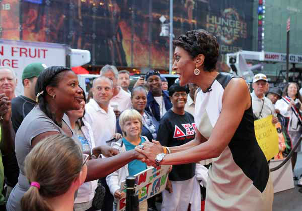 This image released by ABC shows &#34;Good Morning America&#34; co-host Robin Roberts, right, speaking with a fan outside on the popular morning show on Thursday, Aug. 30, 2012 in New York. Roberts has said goodbye to &#34;Good Morning America,&#34; but only for a while. The &#34;GMA&#34; anchor made her final appearance Thursday before going on medical leave for a bone marrow transplant. Roberts&#39; departure was first planned for Friday, but she chose to exit a day early to visit her ailing mother in Mississippi. In July she first disclosed that she has MDS, a blood and bone marrow disease. She will be hospitalized next week to prepare for the transplant. The donor will be her older sister, Sally-Ann Roberts. &#40;AP Photo&#47;ABC, Fred Lee&#41; <span class=meta>(AP Photo&#47; Fred Lee)</span>