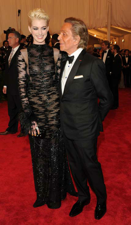 "<div class=""meta ""><span class=""caption-text "">Actress Anne Hathaway and designer Valentino Garavani attend The Metropolitan Museum of Art's Costume Institute benefit celebrating ""PUNK: Chaos to Couture"" on Monday, May 6, 2013 in New York. (Photo by Evan Agostini/Invision/AP) (AP Photo/ Evan Agostini)</span></div>"
