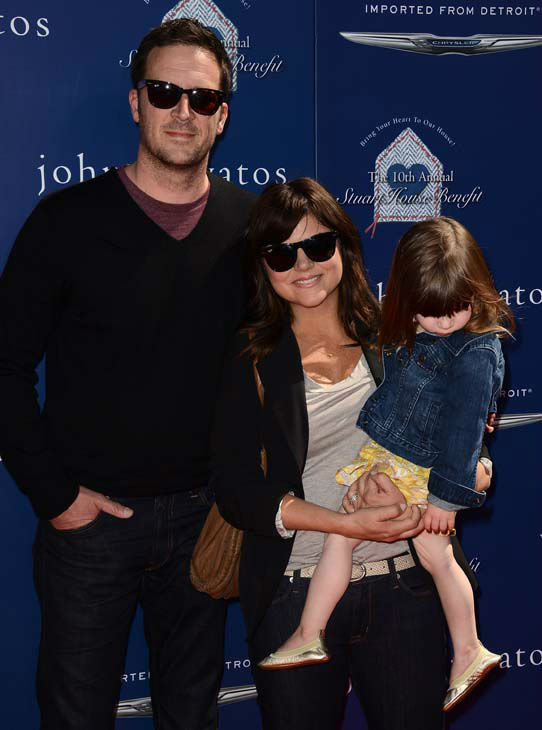 Tiffani Thiessen, left, and Brady Smith arrive at The John Varvatos 10th Annual Stuart House Benefit at the John Varvatos Boutique on Sunday, March 10, 2013 in Los Angeles. &#40;Photo by Jordan Strauss&#47;Invision&#47;AP&#41; <span class=meta>(Photo&#47;Jordan Strauss)</span>