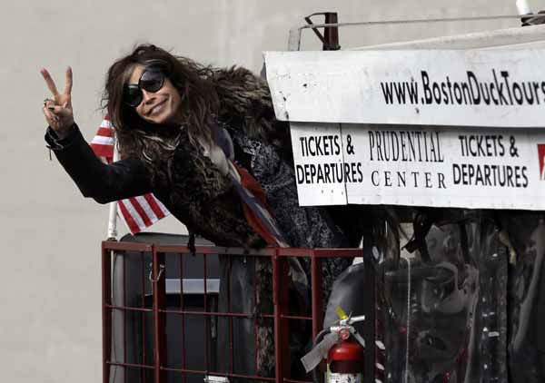 Aerosmith&#39;s Steven Tyler gestures after climbing aboard a duck boat which transported the band Monday, Nov. 5, 2012  to Boston&#39;s Allston neighborhood where they gave a free concert. Aerosmith performed in front of the building which was their home in the early 1970&#39;s. &#40;AP Photo&#47;Elise Amendola&#41; <span class=meta>(AP Photo&#47; Elise Amendola)</span>