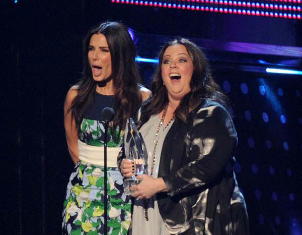 From left, Sandra Bullock and Melissa McCarthy accept the Favorite Comedic Movie award for The Heat at the 40th annual People&#39;s Choice Awards at Nokia Theatre L.A. Live on Wednesday, Jan. 8, 2014, in Los Angeles. &#40;Photo by Frank Micelotta&#47;Invision&#47;AP&#41; <span class=meta>(Photo&#47;Frank Micelotta)</span>