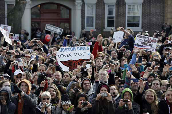Fans line up along Commonwealth Avenue, Monday, Nov. 5, 2012 in Boston&#39;s Allston neighborhood to watch a free concert by Aerosmith whose band members lived there in the early 1970&#39;s. &#40;AP Photo&#47;Elise Amendola&#41; <span class=meta>(AP Photo&#47; Elise Amendola)</span>