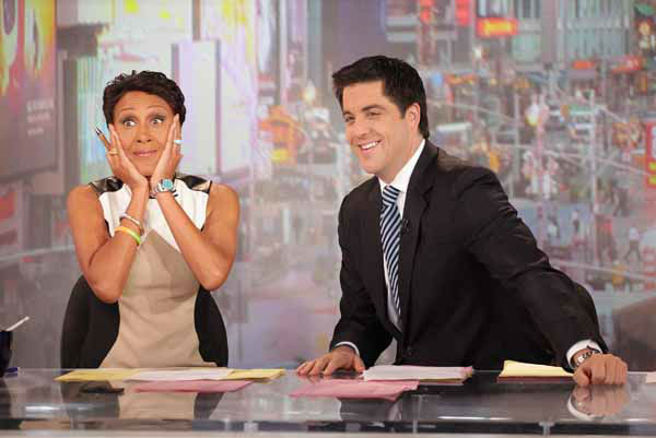 This image released by ABC shows &#34;Good Morning America&#34; co-host Robin Roberts, left, and co-host Josh Elliott on the popular morning show on Thursday, Aug. 30, 2012 in New York. Roberts has said goodbye to &#34;Good Morning America,&#34; but only for a while. The &#34;GMA&#34; anchor made her final appearance Thursday before going on medical leave for a bone marrow transplant. Roberts&#39; departure was first planned for Friday, but she chose to exit a day early to visit her ailing mother in Mississippi. In July she first disclosed that she has MDS, a blood and bone marrow disease. She will be hospitalized next week to prepare for the transplant. The donor will be her older sister, Sally-Ann Roberts. &#40;AP Photo&#47;ABC, Fred Lee&#41; <span class=meta>(AP Photo&#47; Fred Lee)</span>