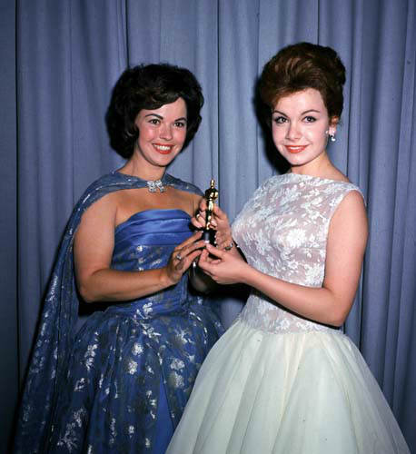 Actress Annette Funicello, right, and former child film star Shirley Temple, left, are seen holding a miniature Oscar statuette at the annual Academy Awards presentations, in Los Angeles, Calif., in April 1961. &#40;AP Photo&#47;Brich&#41; <span class=meta>(AP Photo&#47; BRICH)</span>