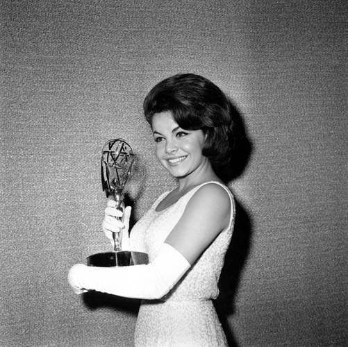 Former Mouseketeer Annette Funicello accepts on behalf of Walt Disney studios the Emmy for best children&#39;s programming, &#34;Walt Disney&#39;s Wonderful World of Color,&#34; at the Emmy Awards ceremony in Hollywood, Calif., on May 26, 1963.    &#40;AP Photo&#41; <span class=meta>(AP Photo&#47; XCB)</span>