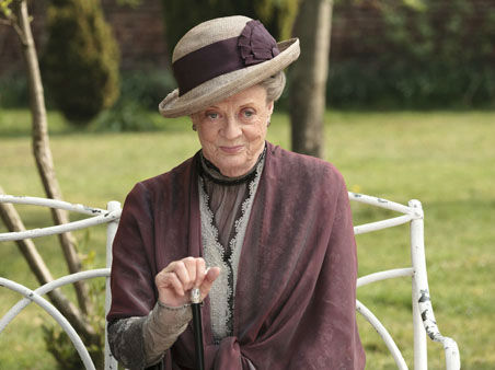 In this image released by PBS,  Maggie Smith as the Dowager Countess Grantham, is shown in a scene from the second season on &#34;Downton Abbey.&#34;  Smith was nominated for a Golden Globe award for best supporting actress in mini-series or TV movie for her role in the series, Thursday, Dec. 13, 2012. The 70th annual Golden Globe Awards will be held on Jan. 13.  &#40;AP Photo&#47;PBS, Carnival Film &amp; Television Limited 2011 for MASTERPIECE, Nick Briggs&#41; <span class=meta>(AP Photo&#47; Nick Briggs)</span>