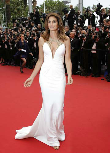 "<div class=""meta ""><span class=""caption-text "">FILE - This May 15, 2013 file photo shows model Cindy Crawford wearing a Roberto Cavalli white gown with plunging beaded neckline as she arrives for the opening ceremony and the screening of The Great Gatsby at the 66th international film festival, in Cannes, southern France. (AP Photo/Francois Mori) (AP Photo/ Francois Mori)</span></div>"
