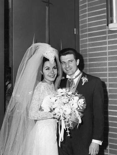 "<div class=""meta ""><span class=""caption-text "">Annette Funicello, former member of the Disney Mousketeer club, leaves St. Cyril's Roman Catholic church in Encino, Calif., on Jan. 9, 1965, with her husband and agent, Jack Gilardi, after their marriage. She is 22 and he is 34. (AP Photo/David Smith) (AP Photo/ David Smith)</span></div>"
