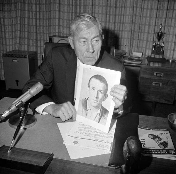 Chicago Police Superintendent O.W. Wilson holds a photograph of a man he identified as Richard B. Speck, 25, in Chicago, July 16, 1966. Wilson said a warrant had been issued for Speck in connection with the slaying of eight student nurses. Fingerprints found at the scene of the slaying matched Speck&#39;s, Wilson said.  The Speck murders had a jarring effect on characters in the Sunday, April 8, 2012, episode of &#39;&#39;Mad Men.&#39;&#39; &#40;AP Photo&#41; <span class=meta>(AP Photo&#47; RS)</span>