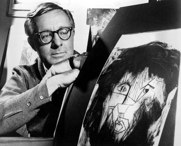 Science fiction writer Ray Bradbury looks at a picture that was part of a school project to illustrate characters in one of his dramas in Hollywood, Ca.,  Dec. 8, 1966.  &#40;AP Photo&#41; <span class=meta>(AP Photo&#47; XNBG)</span>