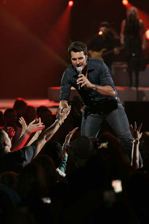 This image released by NBC Universal shows country singer Luke Bryan during the Healing in the Heartland: Relief Benefit Concert at the Chesapeake Energy Arena in Oklahoma City, Okla., Wednesday, May 29,2013. Funds raised by the benefit will go to the United Way of Central Oklahoma, for recovery efforts for those affected by the May 20 tornado. &#40;AP Photo&#47;NBC, Brett Deering&#41; <span class=meta>(AP Photo&#47; Brett Deering)</span>