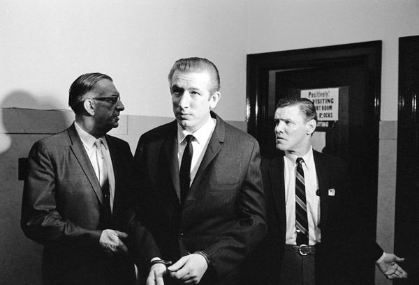 Convicted slayer Richard Speck is led by court bailiffs toward courtroom in Chicago, May 15, 1967. He was brought into court to hear his defense counsel present appeals. He was convicted in Perioa after he obtained a change of venue. &#40;AP Photo&#47;Charles Harrity&#41; <span class=meta>(AP Photo&#47; Charles Harrity)</span>