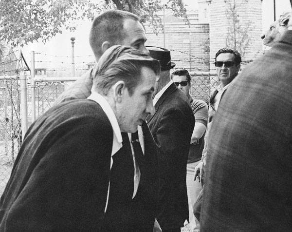Richard Speck, foreground, left, accompanied by heavy police guard, arrives at the state prison at Joliet, Ill., June 5, 1967. Earlier in the day at Peoria, he heard Judge Herbert C. Paschen sentence him to die in the electric chair. &#40;AP Photo&#41; <span class=meta>(AP Photo&#47; IP KP, GP. KEY A1, D. XMB)</span>