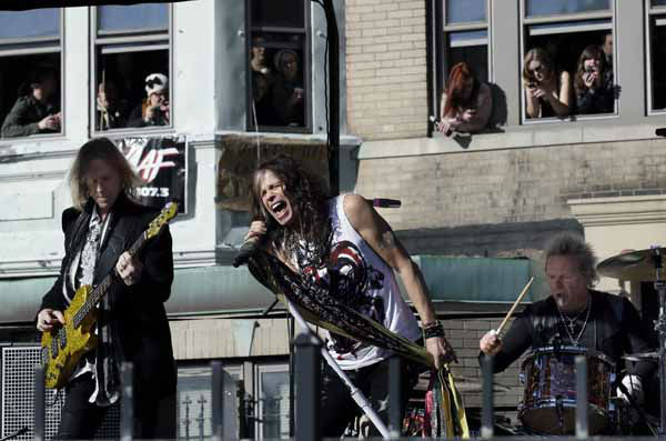 Aerosmith members, from left, Tom Hamilton, Steven Tyler and Joey Kramer perform a free concert Monday, Nov. 5, 2012 in Boston&#39;s Allston neighborhood as fans watch from the apartment building which was their home in the early 1970&#39;s. &#40;AP Photo&#47;Elise Amendola&#41; <span class=meta>(AP Photo&#47; Elise Amendola)</span>