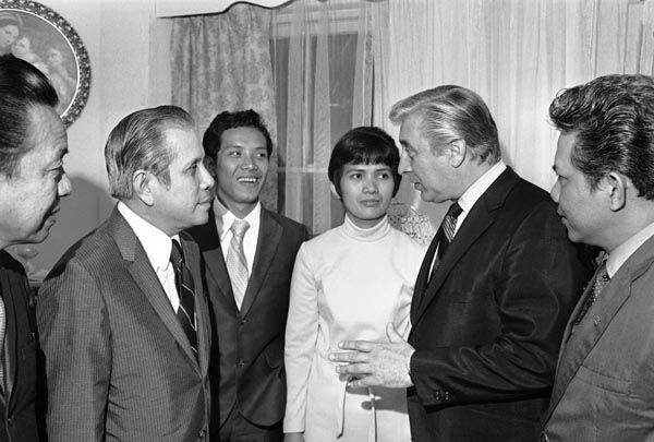 Corazon Amurao Atienza, lone survivor of the mass murder of eight nurses in Chicago four years ago, is guest at a Philippine Embassy official&#39;s home in Washington, July 14, 1970 after spending part of the anniversary praying at St. Matthew&#39;s Cathedral. With her, from left, are Philippine Ambassador Ernesto V. Lagdsmeo; Alberto Atienza, her husband; and Rep. Roman C. Pucinski, D-Ill. &#40;AP Photo&#47;Harvey Georges&#41; <span class=meta>(AP Photo&#47; Harvey Georges)</span>
