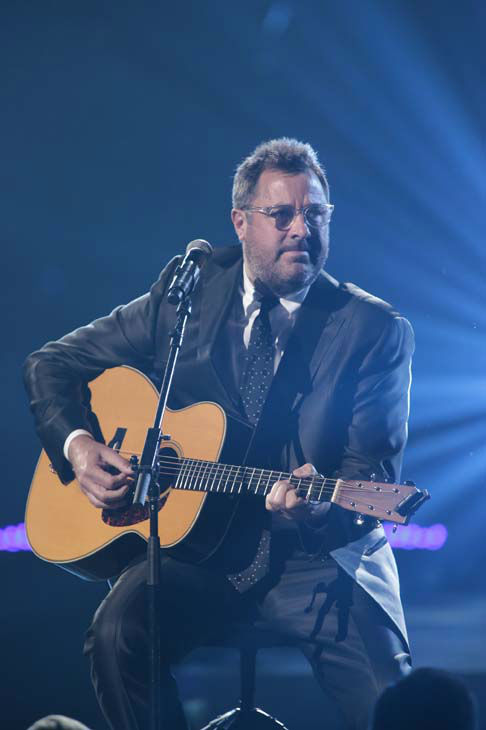 This image released by NBC Universal shows country singer Vince Gill  during the Healing in the Heartland: Relief Benefit Concert at the Chesapeake Energy Arena in Oklahoma City, Okla., Wednesday, May 29,2013. Funds raised by the benefit will go to the United Way of Central Oklahoma, for recovery efforts for those affected by the May 20 tornado. &#40;AP Photo&#47;NBC, Brett Deering&#41; <span class=meta>(AP Photo&#47; Brett Deering)</span>