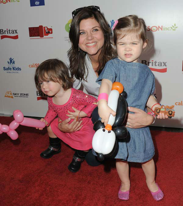 Tiffani Thiessen attends the 2nd Annual Red CARpet event at the SLS Hotel on Saturday, Sept. 8, 2012 in Beverly Hills, Calif. &#40;Photo by Jordan Strauss&#47;Invision&#47;AP&#41; <span class=meta>(Photo&#47;Jordan Strauss)</span>