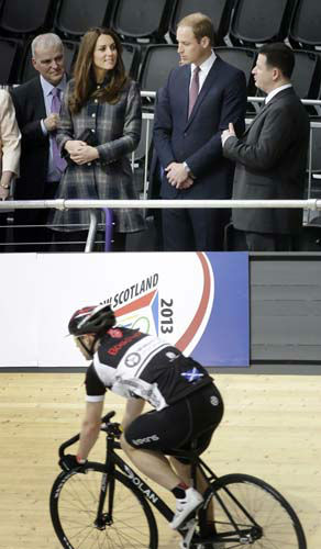 Britain&#39;s Prince William, the Duke of Cambridge, centre, and his wife Kate, the Duchess of Cambridge, during their visit to the Emirates Arena in Glasgow, Scotland, Thursday, April 4, 2013. &#40;AP Photo&#47;Danny Lawson, Pool&#41; <span class=meta>(AP Photo&#47; Danny Lawson)</span>
