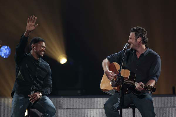 This image released by NBC Universal shows country singer Blake Shelton, right, and Usher during the Healing in the Heartland: Relief Benefit Concert at the Chesapeake Energy Arena in Oklahoma City, Okla., Wednesday, May 29,2013. Funds raised by the benefit will go to the United Way of Central Oklahoma, for recovery efforts for those affected by the May 20 tornado. &#40;AP Photo&#47;NBC, Brett Deering&#41; <span class=meta>(AP Photo&#47; Brett Deering)</span>