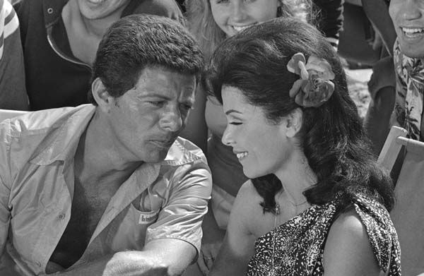 Working together again after a separation of ten years Frankie Avalon and Annette Funicello chat during a break in the filming of another beach movie in Los Angeles, Aug. 26, 1977.  &#40;AP Photo&#47;Jeff Robbins&#41; <span class=meta>(AP Photo&#47; Jeff Robbins)</span>