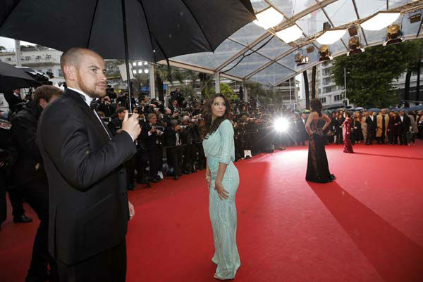 Actress Eva Longoria, center, poses for photographers as she arrives for the screening of the film Jimmy P. Psychotherapy of a Plains Indian at the 66th international film festival, in Cannes, southern France, Saturday, May 18, 2013. &#40;AP Photo&#47;Lionel Cironneau&#41; <span class=meta>(AP Photo&#47; Lionel Cironneau)</span>