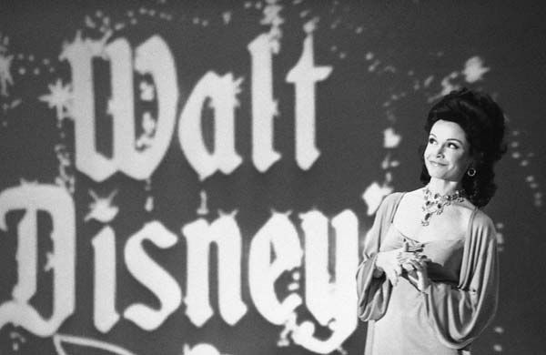 Actress Annette Funicello recalls moments when she played a &#34;Mouseketeer&#34; on ABC&#39;s first successful daytime television show,&#34;The Mickey Mouse Club&#34; in Los Angeles, Jan. 3, 1978. She was taping ABC&#39;s Silver Anniversary Celebration special to be aired on February 5. As Annette looks at the projected background screen, she leads the audience in singing the Mickey Mouse theme song. &#40;AP Photo&#47;Lennox McLendon&#41; <span class=meta>(AP Photo&#47; Lennox McLendon)</span>