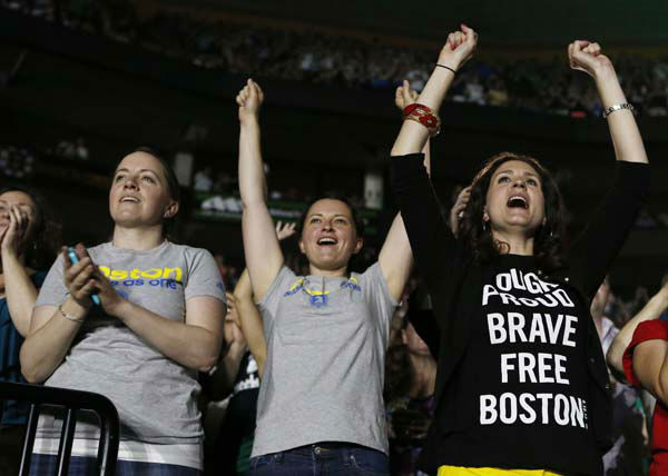 Concert goers react during the Boston Strong Concert: An Evening of Support and Celebration at the TD Garden on Thursday, May 30, 2013 in Boston. &#40;Photo by Bizuayehu Tesfaye&#47;Invision&#47;AP&#41; <span class=meta>(AP Photo&#47; Bizuayehu Tesfaye)</span>