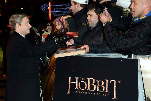 Actor Martin Freeman signs autographs for fans at the UK premiere of &#34;The Hobbit: An Unexpected Journey&#34; at The Odeon Leicester Square, London on Wednesday, Dec. 12, 2012. &#40;Photo by Jon Furniss&#47;Invision&#47;AP&#41; <span class=meta>(Photo&#47;Jon Furniss)</span>