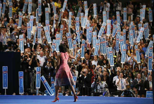 First lady Michelle Obama waves after addressing the Democratic National Convention in Charlotte, N.C., on Tuesday, Sept. 4, 2012. Her dress was designed by American designer Tracy Reese. &#40;AP Photo&#47;Jae C. Hong&#41; <span class=meta>(AP Photo&#47; Jae C. Hong)</span>