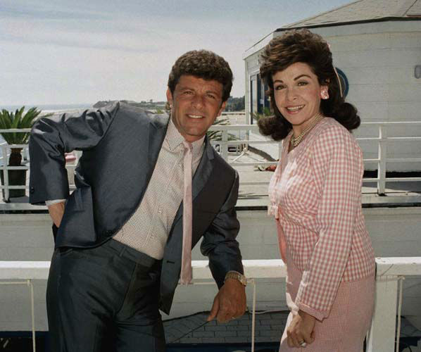 Frankie Avalon and Annette Funicello, who starred in ?Beach Blanket Bingo,? ?How to Stuff a Wild Bikini? and other memorable movies of the mid-Sixties, relax during break in taping of their new movie ?Back to the Beach? in Malibu, Calif., April 13, 1987. They play onetime beach lovers who move to Ohio. &#40;AP Photo&#47;Bob Galbraith&#41; <span class=meta>(AP Photo&#47; Bob Galbraith)</span>