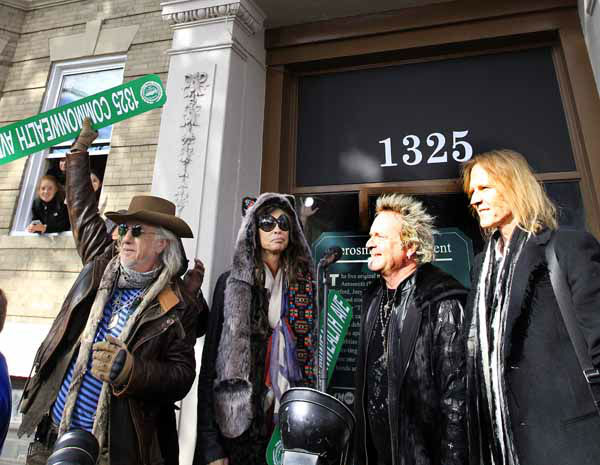 From left, Aerosmith&#39;s Brad Whitford, Steven Tyler, Joey Kramer and Tom Hamilton Monday, Nov. 5, 2012 wave to fans at an address in Boston&#39;s Allston neighborhood which was their home in the early 1970&#39;s. Aerosmith later gave a free concert in front of the building. &#40;AP Photo&#47;Elise Amendola&#41; <span class=meta>(AP Photo&#47; Elise Amendola)</span>