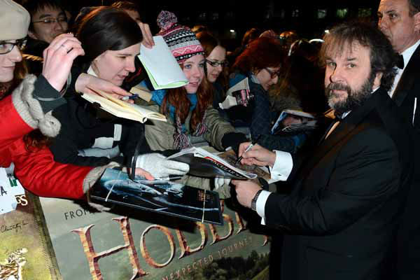 Director Peter Jackson signs autographs at the UK premiere of The Hobbit: An Unexpected Journey at The Odeon Leicester Square, London on Wednesday, Dec. 12, 2012. &#40;Photo by Jon Furniss&#47;Invision&#47;AP&#41; <span class=meta>(Photo&#47;Jon Furniss)</span>