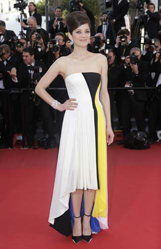 "<div class=""meta ""><span class=""caption-text "">FILE - This May 20, 2013 file photo shows actress Marion Cotillard wearing a multi-colored bustier Dior dress with asymmetric hemline the screening of Blood Ties at the 66th international film festival, in Cannes, southern France. (Photo by Joel Ryan/Invision/AP) (AP Photo/ Joel Ryan)</span></div>"