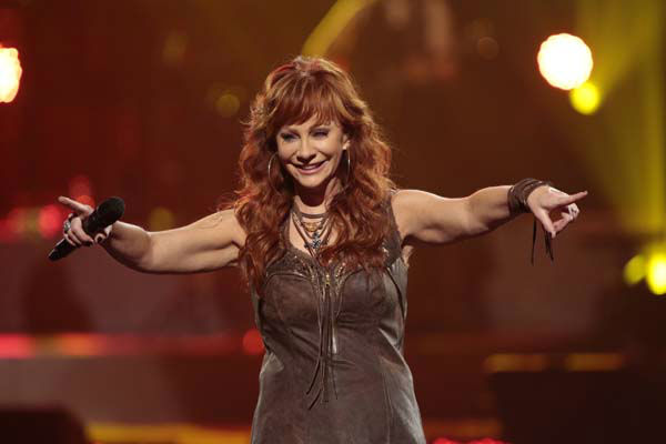 This image released by NBC Universal shows country singer Reba McEntire during the Healing in the Heartland: Relief Benefit Concert at the Chesapeake Energy Arena in Oklahoma City, Okla., Wednesday, May 29,2013. Funds raised by the benefit will go to the United Way of Central Oklahoma, for recovery efforts for those affected by the May 20 tornado. &#40;AP Photo&#47;NBC, Brett Deering&#41; <span class=meta>(AP Photo&#47; Brett Deering)</span>
