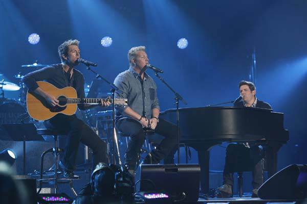 This image released by NBC Universal shows members of  Rascal Flatts, from left, Joe Don Rooney, Gary LeVox and Jay DeMarcus during the Healing in the Heartland: Relief Benefit Concert at the Chesapeake Energy Arena in Oklahoma City, Okla., Wednesday, May 29,2013. Funds raised by the benefit will go to the United Way of Central Oklahoma, for recovery efforts for those affected by the May 20 tornado. &#40;AP Photo&#47;NBC, Brett Deering&#41; <span class=meta>(AP Photo&#47; Brett Deering)</span>