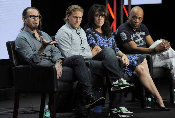 Kurt Sutter, left, creator&#47;executive producer of the FX series &#34;Sons of Anarchy,&#34; takes part in a panel discussion with, left to right, cast members Charlie Hunnam and Katey Sagal and executive producer Paris Barclay during the FX 2013 Summer TCA press tour at the Beverly Hilton Hotel on Friday, Aug. 2, 2013 in Beverly Hills, Calif. &#40;Photo by Chris Pizzello&#47;Invision&#47;AP&#41; <span class=meta>(Photo&#47;Chris Pizzello)</span>