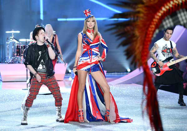 Singer Taylor Swift performs with Patrick Stump, left, and Pete Wentz of Fall Out Boy during the 2013 Victoria&#39;s Secret Fashion Show at the 69th Regiment Armory on Wednesday, Nov. 13, 2013 in New York. &#40;Photo by Evan Agostini&#47;Invision&#47;AP&#41; <span class=meta>(Photo&#47;Evan Agostini)</span>