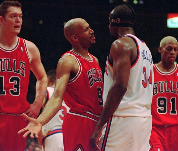 Chicago Bulls guard Ron Harper (9) talks with New York Knicks forward Charles Oakley (34) in the first half Saturday afternoon May 11, 1996 at New York's Madison Square Garden.  (AP Photo/Ron Frehm)