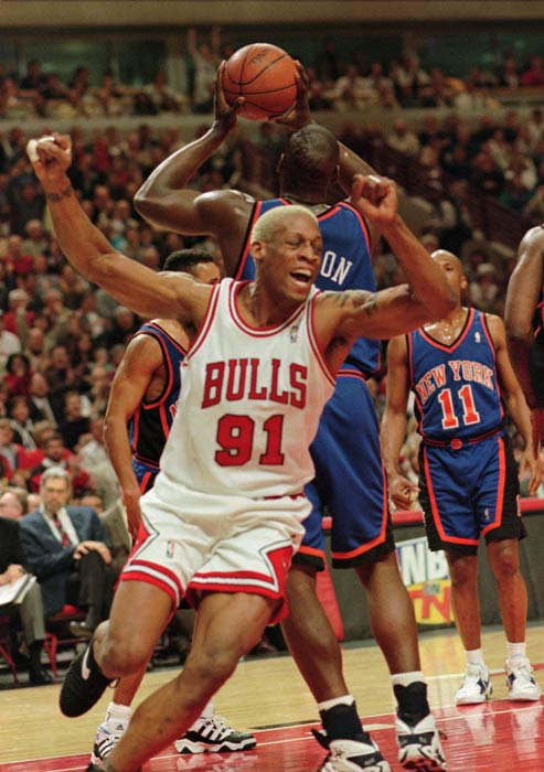 Chicago Bulls forward Dennis Rodman celebrates an early basket over the New York Knicks during the teams' playoff game Tuesday, May 14, 1996, in Chicago.  (AP Photo/Beth A. Keiser)