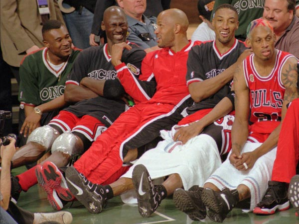 Chicago Bulls' Randy Brown, left, Michael Jordan, Ron Harper, Scottie Pippen and Dennis Rodman relax on the bench in the closing minutes against the Seattle SuperSonics Sunday, June 9, 1996 in Seattle. The Bulls won 108-86. (AP Photo/Bill Chan)