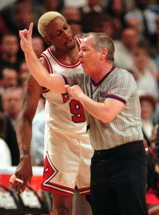 Chicago Bulls' Dennis Rodman argues with referee...