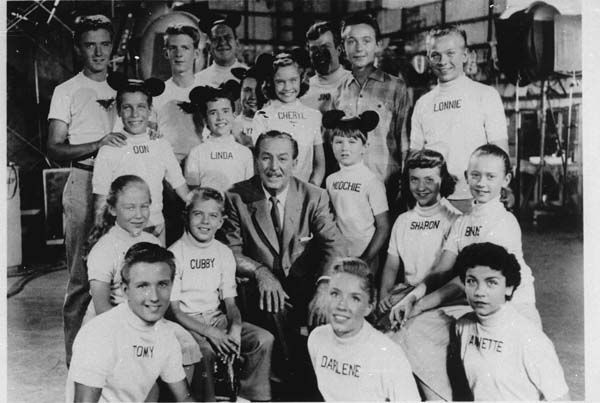 "<div class=""meta ""><span class=""caption-text "">Cast members of the ""Mickey Mouse Club"" surround cartoonist television empire founder Walt Disney in this undated photo released by Disney Television.  (AP Photo/ho) (AP Photo/ Anonymous)</span></div>"
