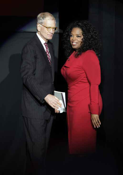 Ball State University alumnus David Letterman, left, host of CBS&#39;s &#34;Late Show,&#34; greets Oprah Winfrey as she takes the stage for an interview at Ball State University in Muncie, Ind., Monday, Nov. 26, 2012. The conversation is part of the David Letterman Distinguished Professional Lecture and Workshop Series. &#40;AP Photo&#47;Michael Conroy&#41; <span class=meta>(AP Photo&#47; Michael Conroy)</span>