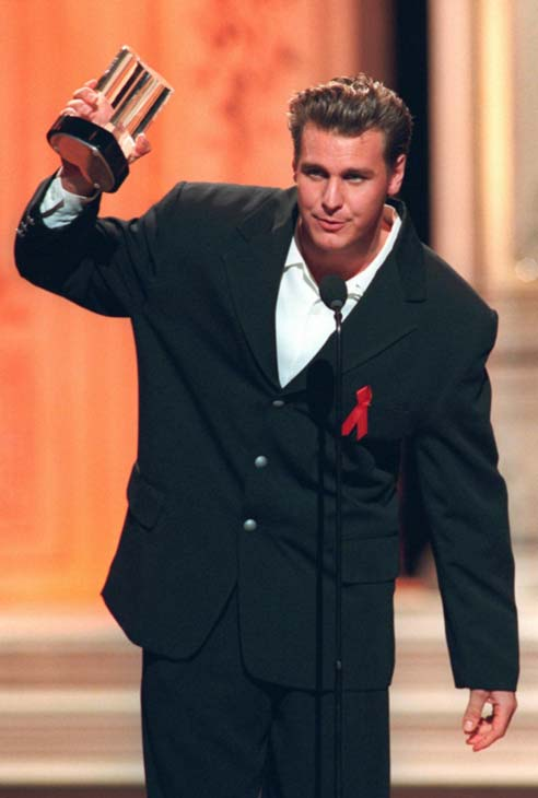 "Ingo Rademacher of ""General Hospital"" raises his award after winning Hottest Male Star at the Soap Opera Digest Awards, Friday, Feb. 27, 1998, at Universal City, Calif.  (AP Photo/Rene Macura)"